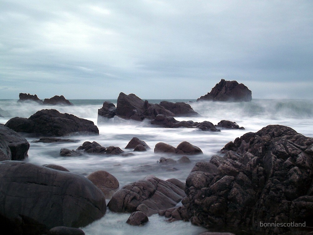 Waves down the beach by bonniescotland