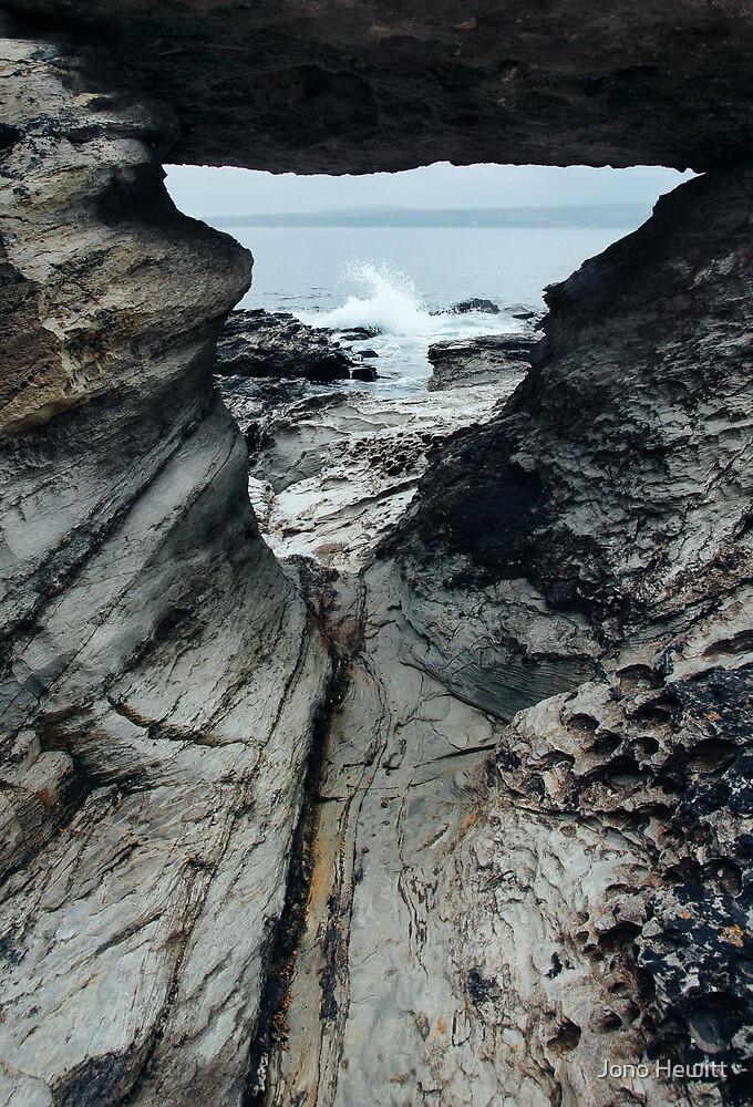 Wave Crash at Low Tide by Jono Hewitt
