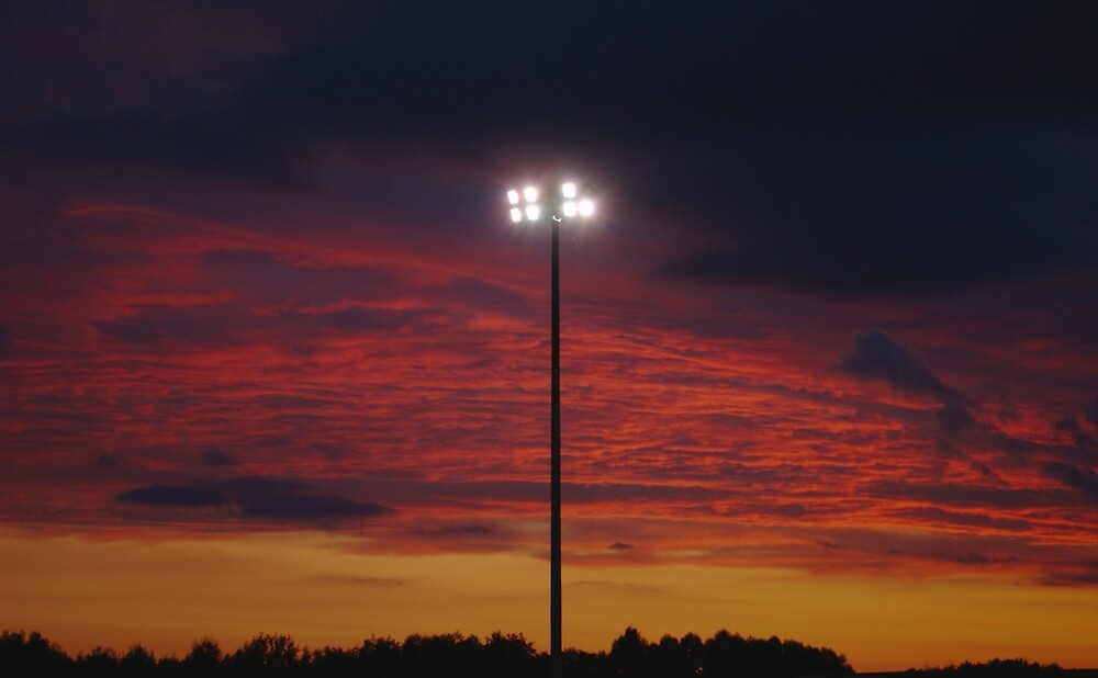 Floodlight At Sunset by Adrian Wale