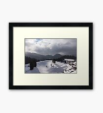 Snowstorm in the Sun - Dancing Snowflakes, Moody Clouds, Long Shadows Framed Print