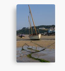 Boat on beach at low tide Canvas Print