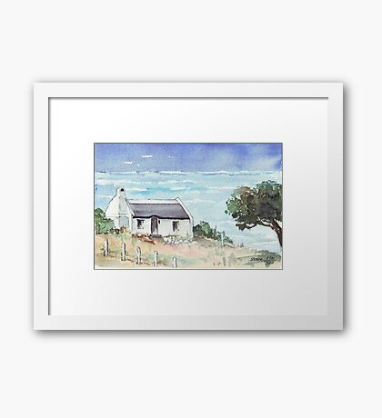 A dream cottage by the sea Framed Print