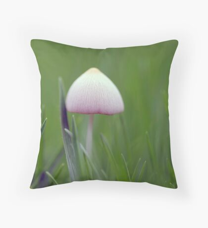 A tiny white mushroom hiding in the grass Throw Pillow