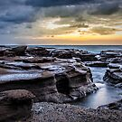 Wet rocks by Chris Brunton