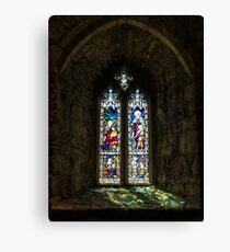 Stained glass window in church, stone frame Canvas Print