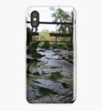 Leaves after a Storm on boardwalk with perspective focus iPhone Case/Skin