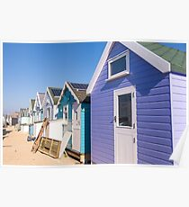 Cluster of pretty pastel beach huts Poster