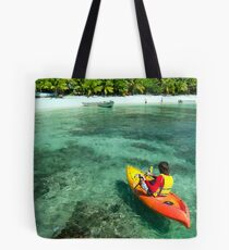 Kayaker on crystal clear tropical water Tote Bag