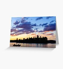 Canoeing at sunset Greeting Card