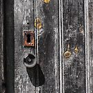 Weathered door, handle and keyhole by Marlene Hielema