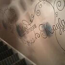Mural of childs name going up stairway by imajica