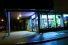 9 O'clock at the Corner Shop on a Wednesday Night by Nigel Bangert