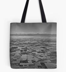 a continent divided Tote Bag
