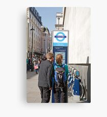 Visitors look at a West End cycle hire map Canvas Print