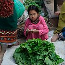 Girl selling lettuce in Bhaktapur by MichaelBr