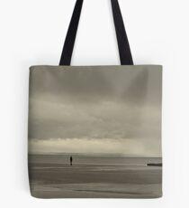 Iron man solitary figure on beach Tote Bag