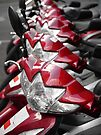 Red motorbikes by David Carton