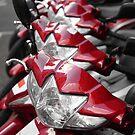 Red motorbikes by David Carton
