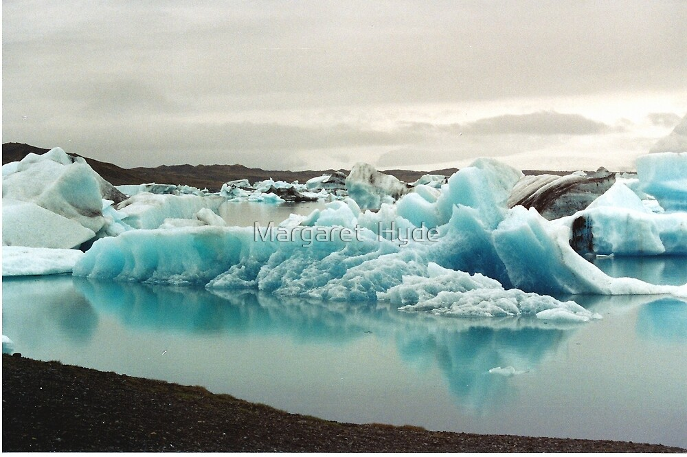 Icebergs in Jokulsarlon, Iceland by Margaret  Hyde