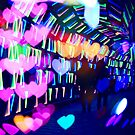 Couple In Colorful Light Tunnel Hearts Triangles Tokyo by Beverly Claire Kaiya