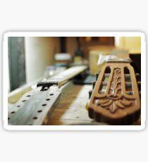 Guitar grips repairing shallow dof Sticker