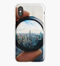 Man holding a lens over Manhattan iPhone Case