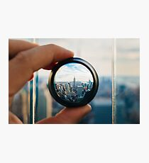Man holding a lens over Manhattan Photographic Print