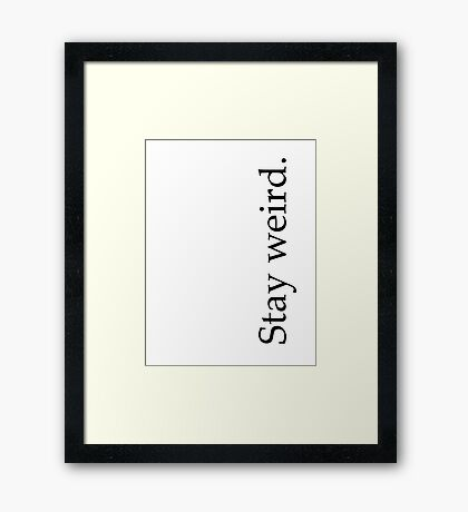 stay weird. Framed Print