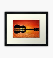 guitar island sunset Framed Print