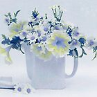 Teapot Of Yellow And Blue Petunias And Daisies  by Sandra Foster