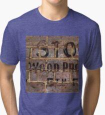 Vintage writing on brick wall  Tri-blend T-Shirt