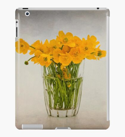 A glass filled with buttercups iPad Case/Skin