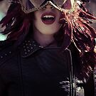 Sensual brunette woman with flowing hair and jacket with golden wings by Fernando Cortés