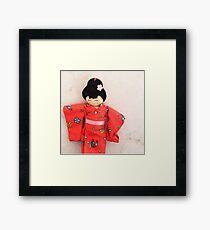 Chinese doll Framed Print