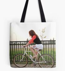 A Girl on her bicycle  Tote Bag