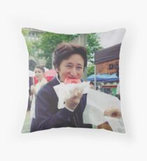 Araki eating a donut Throw Pillow
