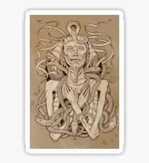 image of pharaoh mummy with snakes on parchment Sticker