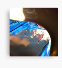 woman applying silver nail polish on finger tips Canvas Print