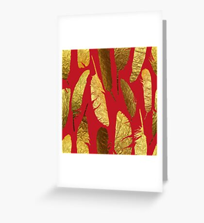 - Golden feather on a red background - Greeting Card