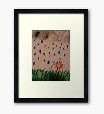 flower in the rain Framed Print
