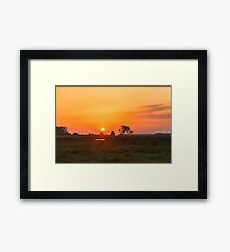 Sunset over the meadow Framed Print