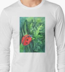 Red cute ladybird sitting on a leaf of grass Long Sleeve T-Shirt