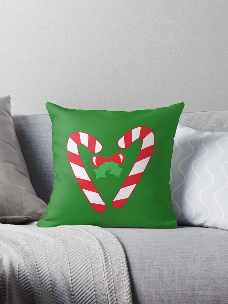 Christmas candy canes with a bow by jazzydevil