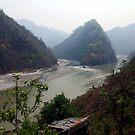 Misty River, Pokhara, Nepal. by John Dalkin