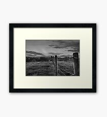 Barbed wire, angry sky.  Framed Print