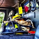 Two Firefighter's Helmets Inside Fire Truck by Susan Savad