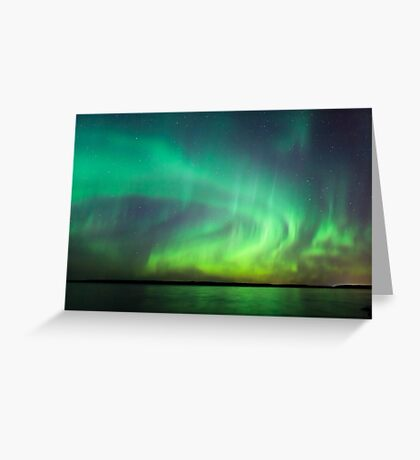 Northern lights over lake in Finland Greeting Card
