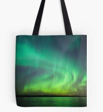 Northern lights over lake in Finland Tote Bag