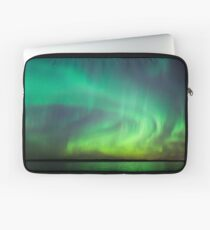 Northern lights over lake in Finland Laptop Sleeve