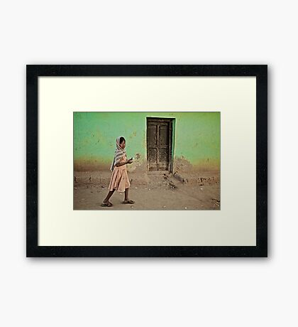 A Girl by a Door Framed Print